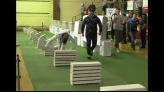 رکوردشکنی تکواندوکار بوسنیایی با شکستن 111 بلوک با سر!!(دیدنی)