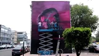 طرح گرافیکی زیبا بر روی ساختمانی در شهر مکزیکوسیتی بسیار زیبا_تایم لپس