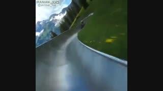 سرسره ای درتپه های سرسبز با منظره کوه های برفی الپ سوئیس