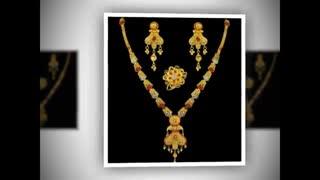 نیم ست زنانه طرح طلا شامل گردنبند و گوشواره رنگ ثابت